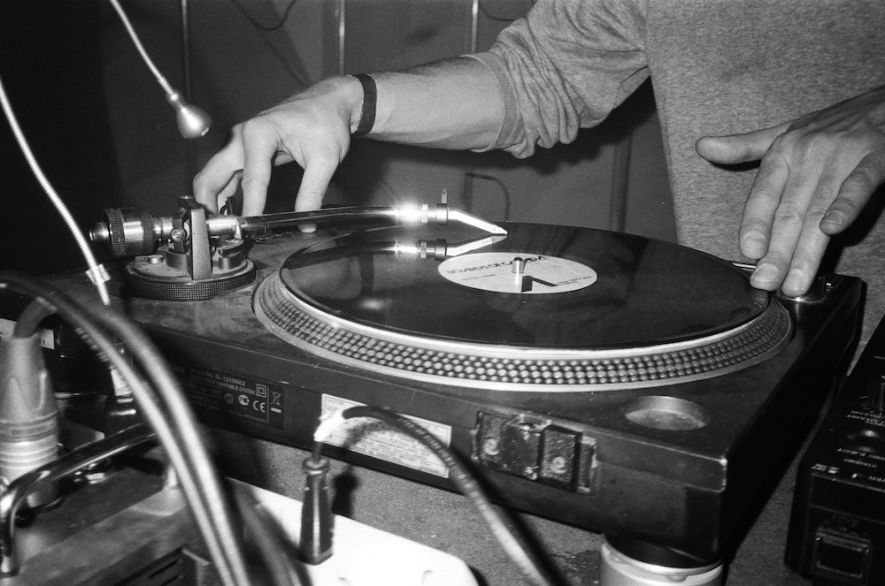 Man djing with a record player